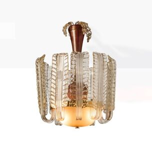 1933-1934's chandelier made of leaves in transparent glass with application of gold leaf.  Bowl in lattimo glass with application of gold leaf and stem in tramonto glass.