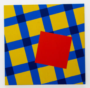 The orange square on the yellow-blue table-cloth