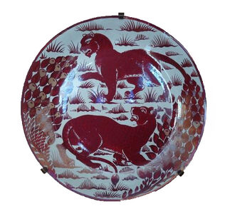 Red Lustre Charger decorated with two Pumas