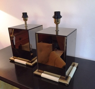 Pair of rare table lamps in mirror.