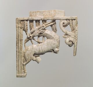 Openwork furniture plaque with a grazing oryx in a forest of fronds
