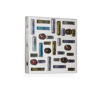 A light panel with a chromed metal structure and coloured glass elements