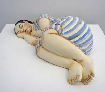 Sleeping Woman in Blue and White Stripe Dress