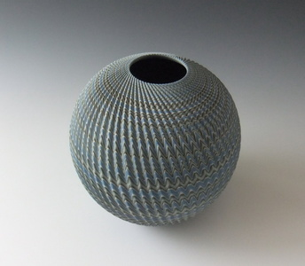 Round neriage (marbleized) vessel with pleated surface