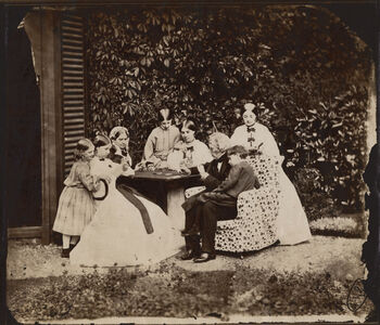 Hassard Dodson Family Sitting Round a Table Playing Cards
