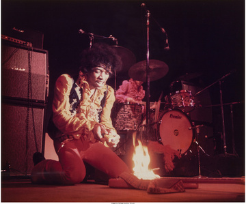 Jimi Hendrix setting his guitar on fire