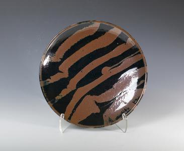 Plate, tenmoku and kaki glaze with trailed decoration