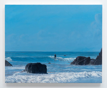Surfer with Rocky Shore