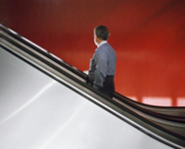 Untitled NY (man on escalator w/ red wall)