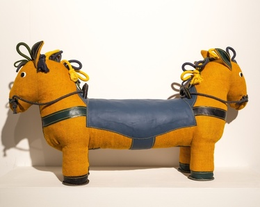 Therapeutic Toy Double-Face Pony in yellow, designed and made by Renate Müller