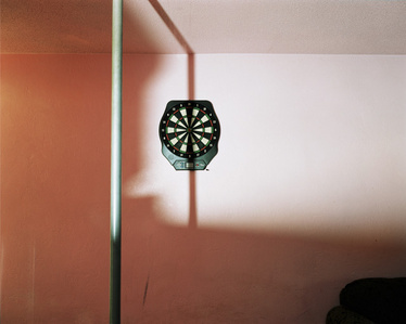 Dartboard and stripper pole at swinger's club, Daytona Bech, Florida