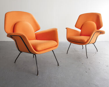 Pair of orange upholstered armchairs with iron frames