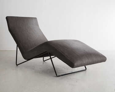 Upholstered lounge chair in grey with a sculptural iron frame