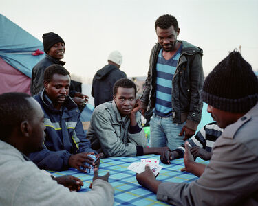 Sudanese men playing cards Calais, France, November 2015 - from the series 'Foreigner'