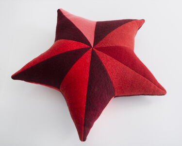 Unique star-shaped patchwork pillow in red cashmere.