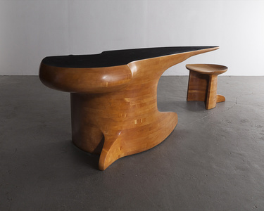 Stack-laminated maple desk with leather top and maple stool.