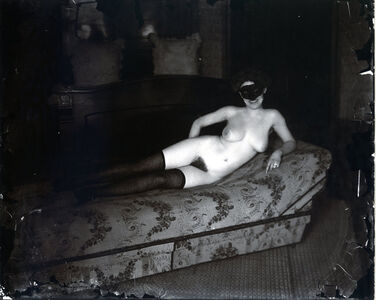 Pl. 69, Woman with Mask on Couch, Storyville Portrait