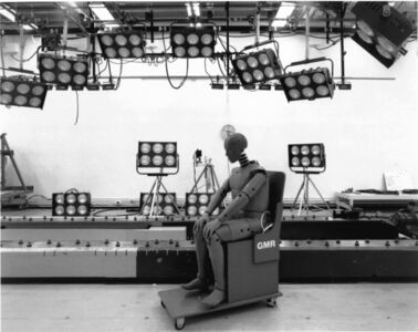 Untitled (test dummy on chair and bright lights)