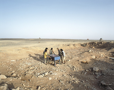 Ubari, Southern Libya, 2015. Tuareg tribe militiamen playing babyfoot on Tende Mount.
