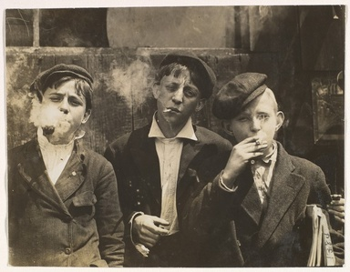11:00 A.M. Monday, May 9th, 1910. Newsies at Skeeter's Branch, Jefferson near Franklin. They were all smoking. Location: St. Louis, Missouri.