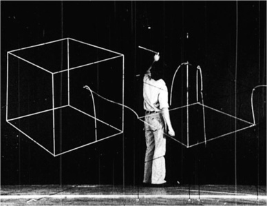 Drawing in the Top of the Cut Cube on the Black Wall (Cubes, Frame No. 04:56:09)