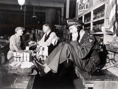 Jimmy Stewart Talking Behind Counter at His Father's Hardware Store While His Father Chats with Customer upon Stewar's Return from WWII, Indiana, PA