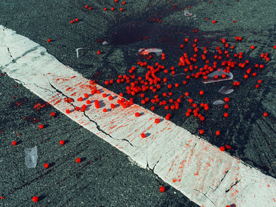 Cherries spilled on crosswalk. New York City, NY. USA