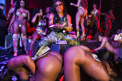 Lauren Greenfield, 'Former stripper OG India helps a rising rapper friend make it rain at Magic City Monday, the club's most important night for aspiring hip-hop stars to make an impression and encourage the strippers to request their music more often, Atlanta', 2015