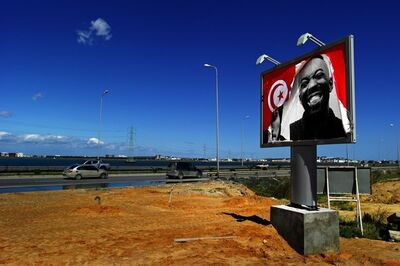 JR, 'INSIDE OUT - Tunisia, Ex Ben Ali Billboard on La Goulette Road', 2011