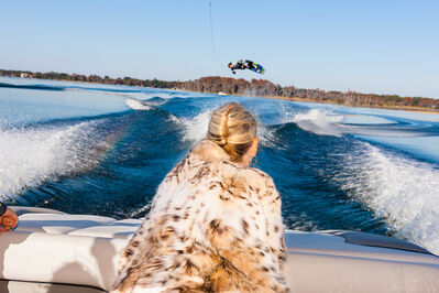 Lauren Greenfield, 'Jackie watches Trevor Hansen, 25, a professional wakeboarder, from a friend's boat, Windermere, Florida, ED 1/5', 2010