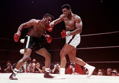 Lawrence Schiller, 'Muhammad Ali defeating Floyd Patterson, Las Vegas, November 1965', 1965