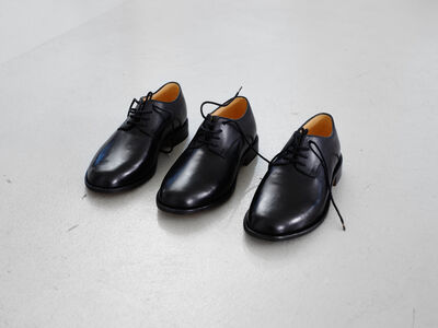 Shoes made for someone with three feet by a master shoemaker in Berlin