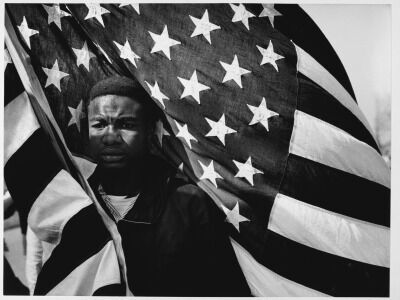 "Lewis ""Big June"" Marshall Carrying the U.S. Flag"