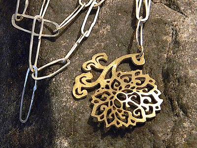 Solid, hand made sterling silver necklace with ornaments pendant