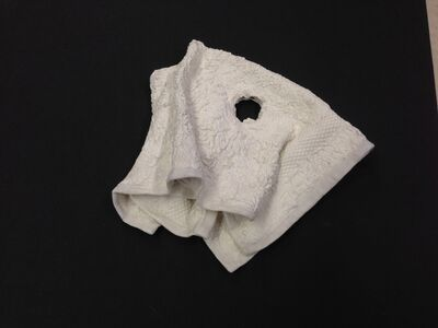 A hole in the wash cloth