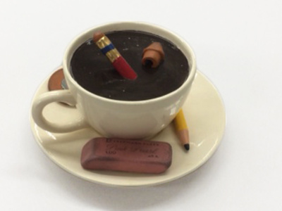 cup with pencils and erasers