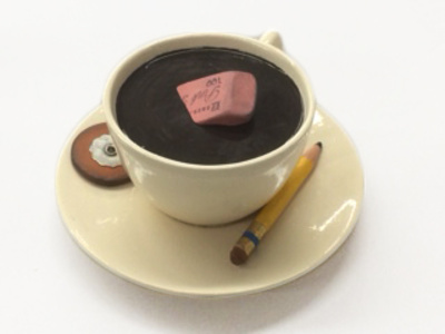 cup with eraser and pencil