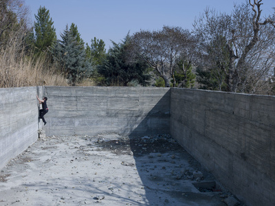 "Mahud climbing the wall of the abandoned swimming pool.  Teheran, Iran.  ""Blank Pages of an Iranian Photo Album"""