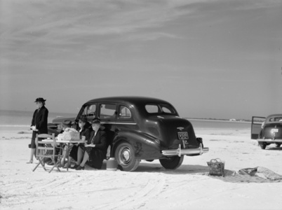 Marion Post Wolcott, Winter Visitors Picnicking on Running Board of Car on Beach, Sarasota, FL