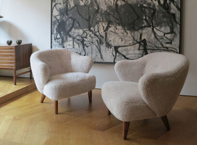 A pair of elegant sheepskin armchairs