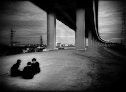 Conspiratorial schoolboys underneath expressway, ShinKoiwa, Tokyo, Japan