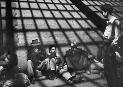 """A group of illegal Mexican immigrants sprawled on floor of border patrol jail cell await deportation back to their homeland during """"Operation Wetback"""", 1955"""