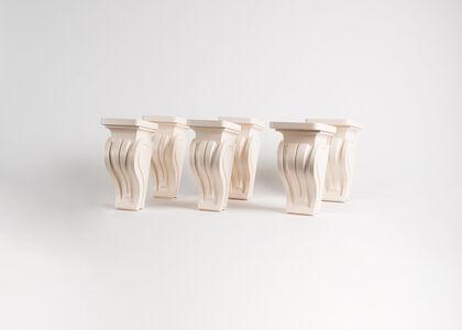 A set of six wall-mounted pedestals
