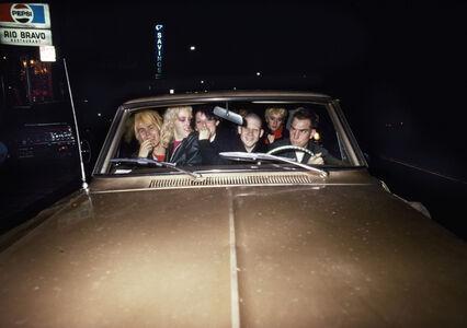 Friends in gold car