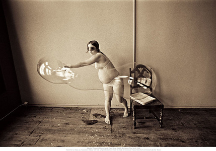 Masked Pregnant Woman with Giant Soap Bubble