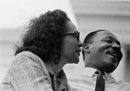 Dr. Martin Luther King, Jr., and wife Coretta Scott King, on speaker's platform for 1965 Selma to Montgomery Civil Rights March - Before Alabama State Capital building and 25,000 civil rights marchers - March 25, 1965