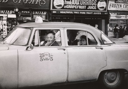 Taxicab driver at the wheel with two passengers, N.Y.C.