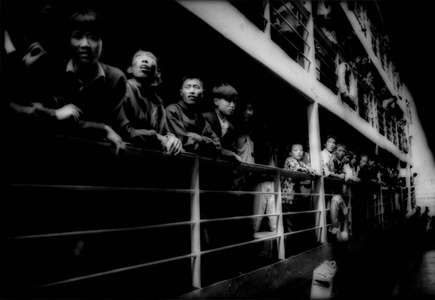 Peasants crowding the rail of a river steamer, Three gorges, Yangtze River, China