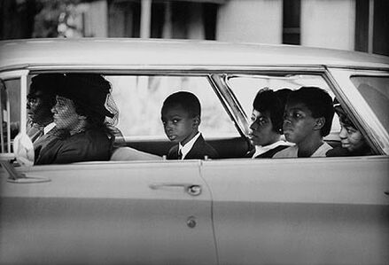 The Chaney family as they depart for the burial of James Chaney, Meridian, Mississippi, August 7, 1964