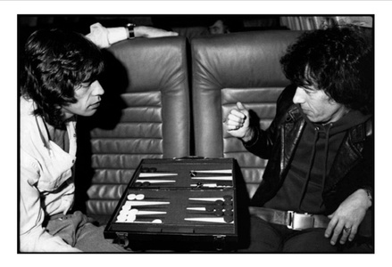 Mick Jagger & Bill Wyman playing Backgammon on the Tour Jet from Chicago to St Louis Checkerdome, November 19, 1981